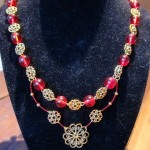 St. Dorothea: A Necklace in Gold and Red