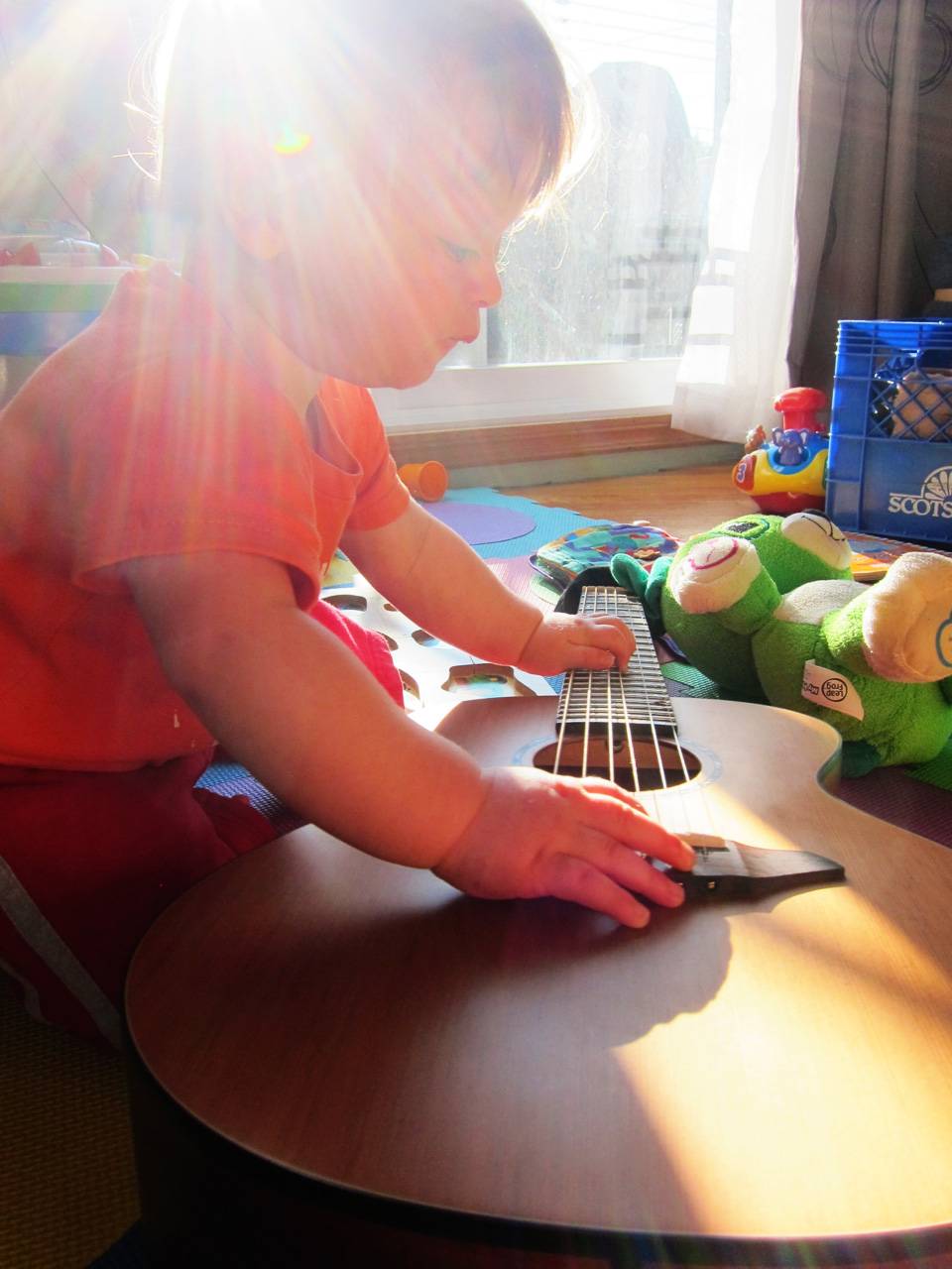Boo playing guitar