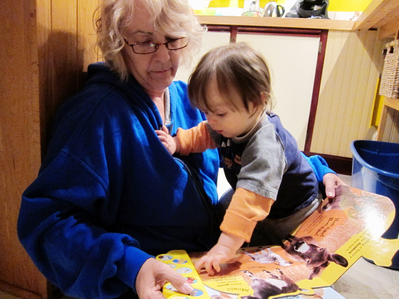 Nana and Boo reading on the floor