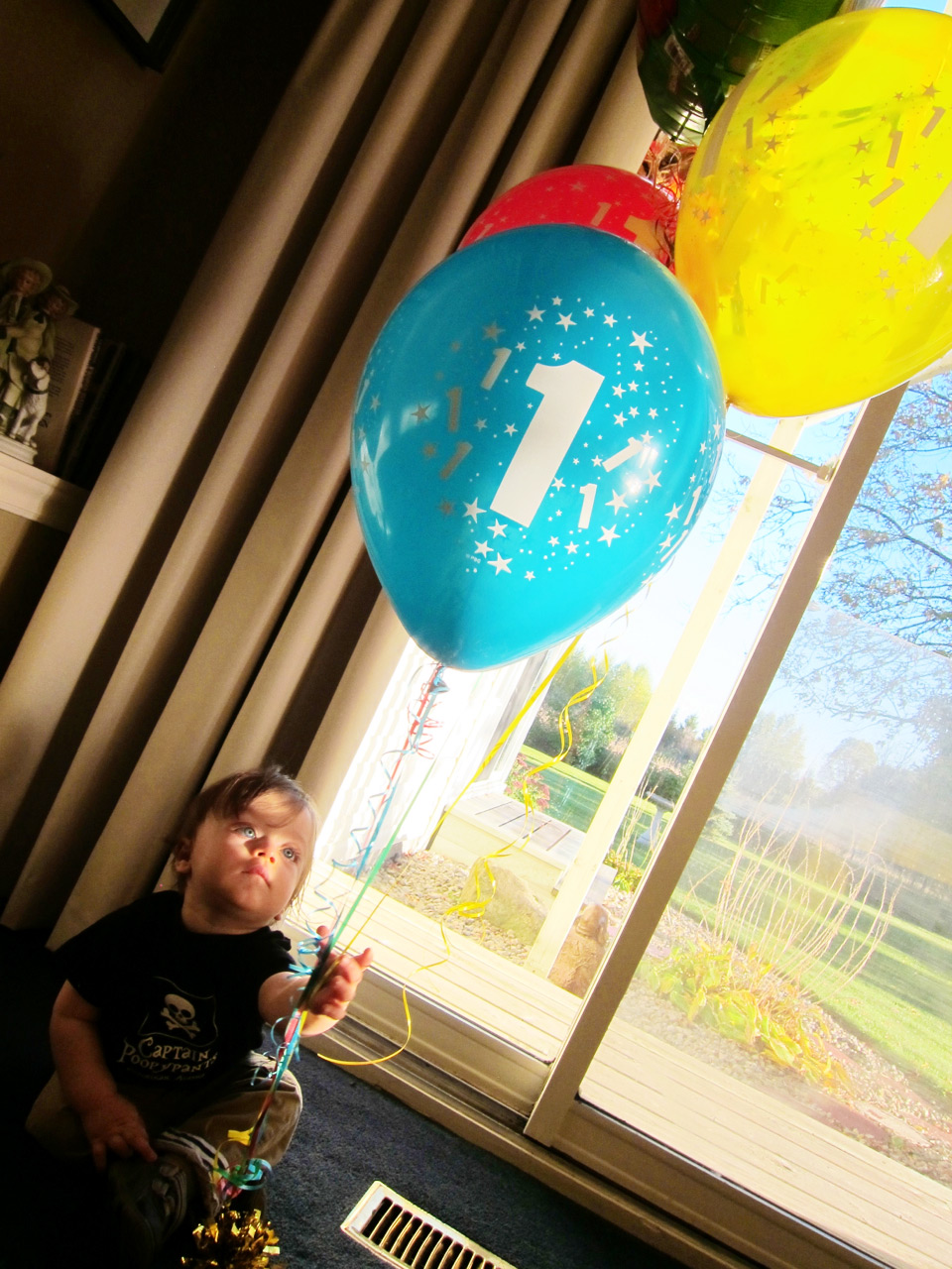 Boo playing with his balloons