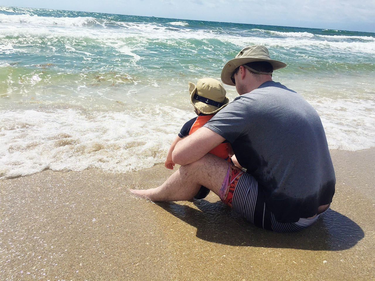 Boo experiencing the waves with Daddy