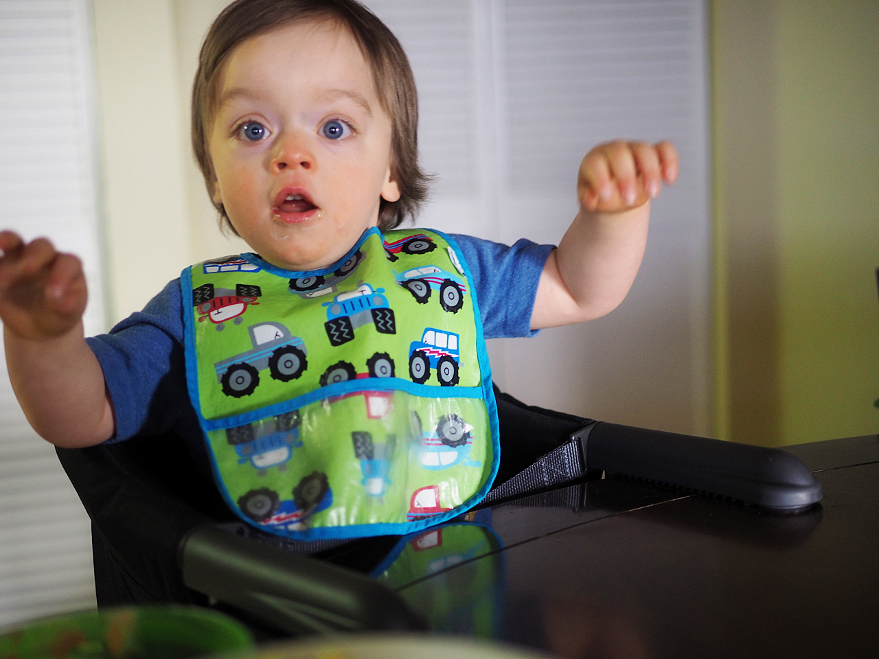Boo excited in his hook-on high chair